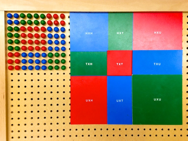 A pegboard used to visualize Binomial and Trinomial multiplication.